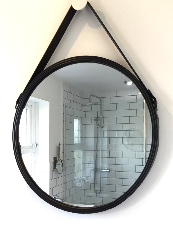 Circular black framed bathroom mirror.jpg